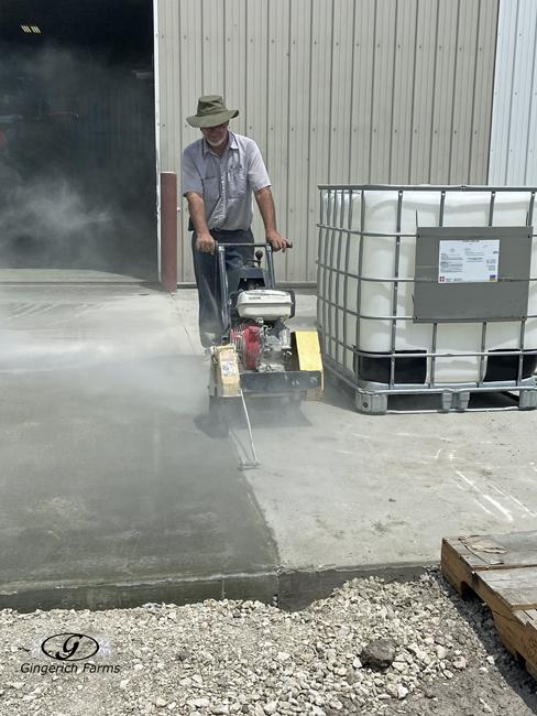 Wilbur cutting concrete - Gingerich Farms