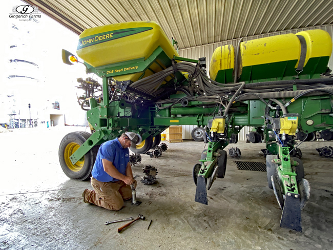 Taking off row cleaners - Gingerich Farms