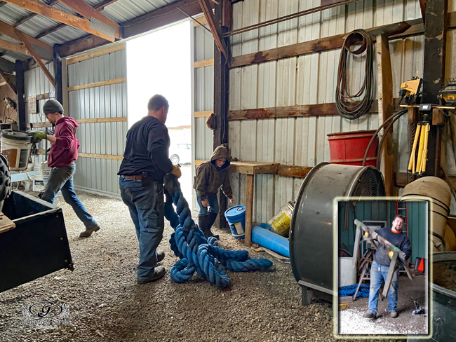Cleaning shed at Gingerich Farms