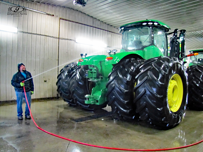 Washing the tractor at Gingerich Farms