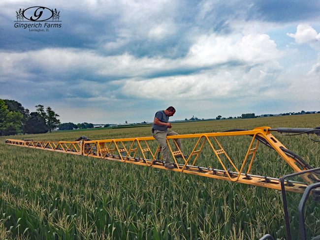 Jadan working on sprayer at Gingerich Farms