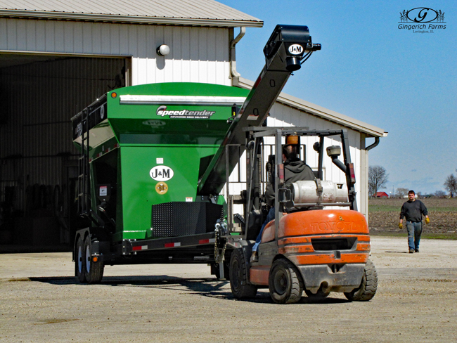 Moving seed tender at Gingerich Farms