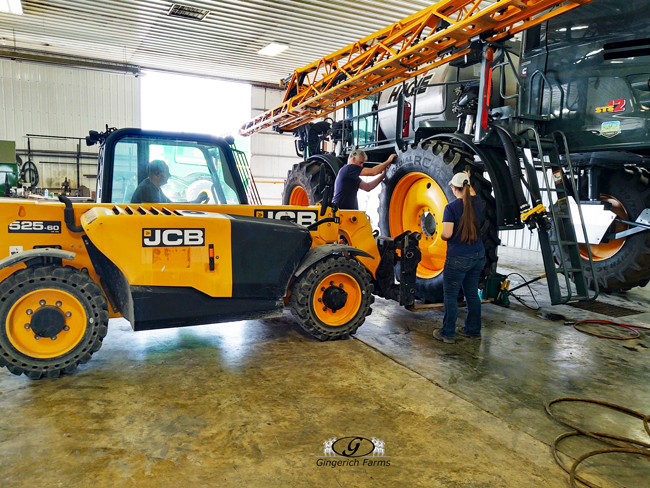 Changing tires on sprayer - Gingerich Farms