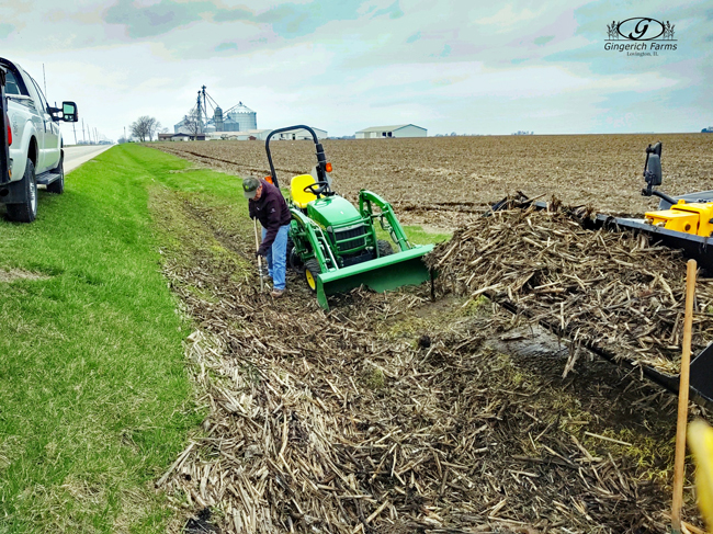Cleaning up stalks at Gingerich Farms