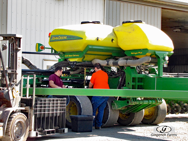 Emptying planter at Gingerich Farms