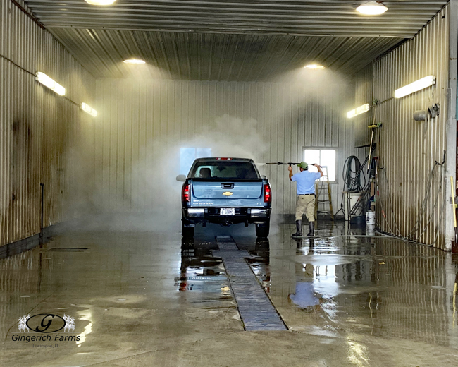 Cleaning truck at Gingerich Farms