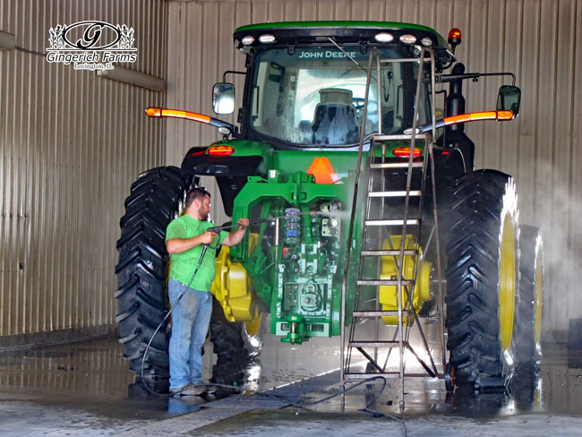 Ethan washing tractor at Gingerich Farms