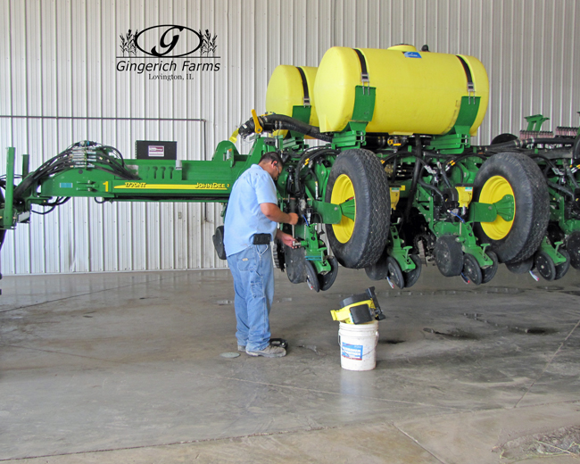 Brandon working on equipment at Gingerich Farms