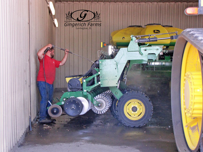 Ethan cleaning equipment at Gingerich Farms