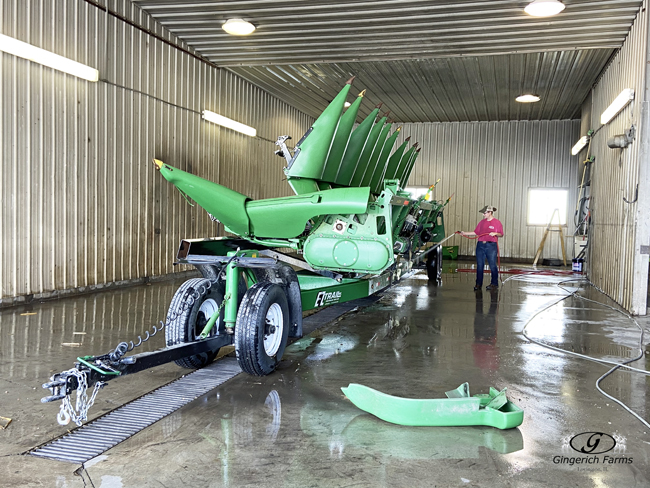 Cleaning corn head at Gingerich Farms