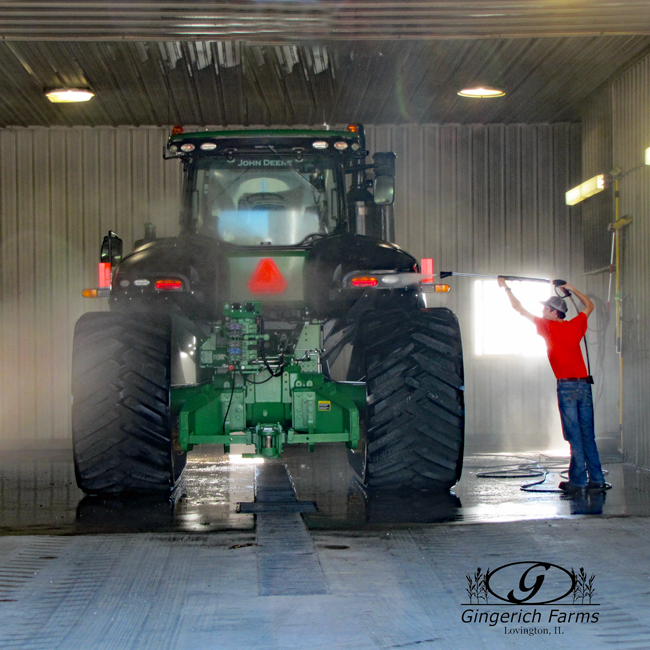 Cleaning tractor at Gingerich Farms