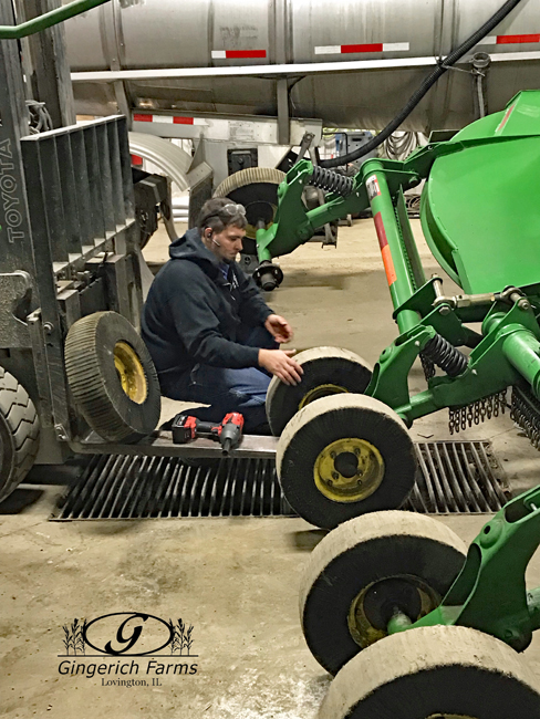 Brandon working on mower at Gingerich Farms