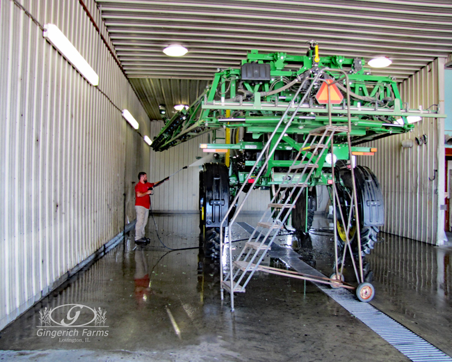 Ethan cleaning the sprayer at Gingerich Farms