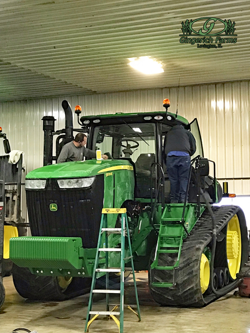 Cleaning tractors at Gingerich Farms