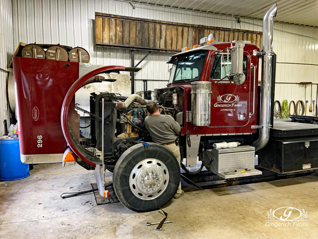 Changing truck oil at Gingerich Farms