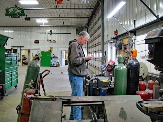 Doug working in shop at Gingerich Farms