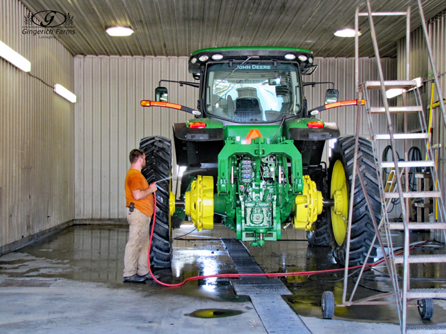 Washing a tractor at Gingerich Farms