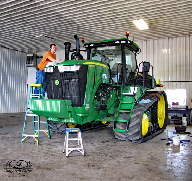 Waxing a tractor at Gingerich Farms
