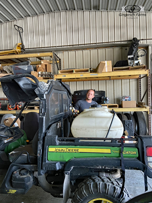 Putting top on gator - Gingerich Farms