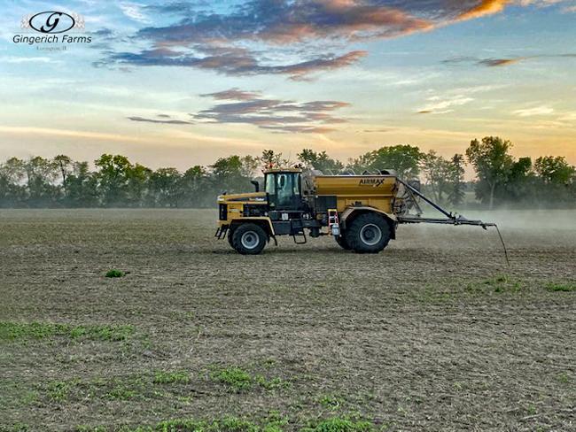 Spreading fertilizer - Gingerich Farms