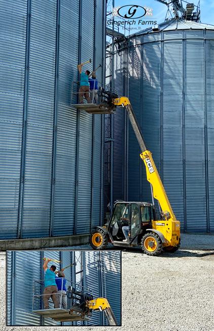 Cleaning corn bin - Gingierch Farms