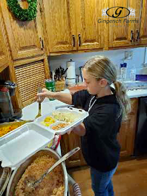 Kylie dishing up dinner - Gingerich Farms