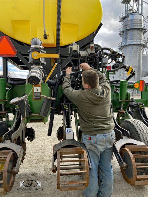 Putting camera on - Gingerich Farms