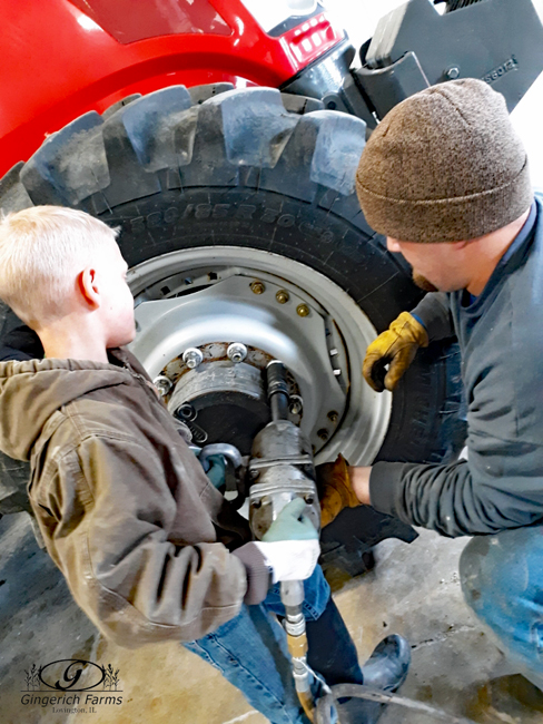 Changing tire at Gingerich Farms