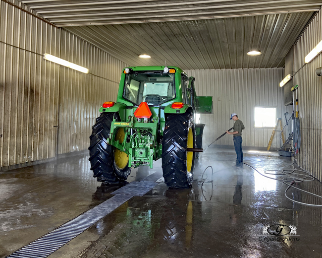 Cleaning tractor - Gingerich Farms